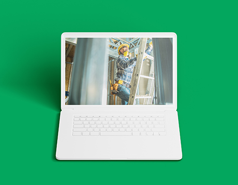 Computer on green background